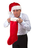 Man in Santa Hat Surprised at Stocking Contents Royalty Free Stock Photo