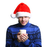 Man in Santa's hat with cup Stock Photography