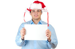 Man in santa's hat holding empty blank card Stock Image