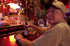 A man sat at a bar, Mississippi Royalty Free Stock Photo
