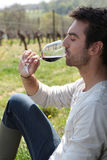 Man sat drinking red wine Royalty Free Stock Photography