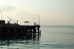 The man sat fishing evening bridge and sea beautiful. Shamul Island Stock Photo