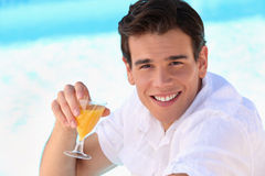 Man sat poolside Stock Images