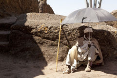 Man sat under an umbrella, Ethiopia Stock Photo