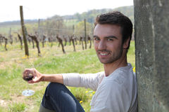 Man sat by a vineyard Royalty Free Stock Images
