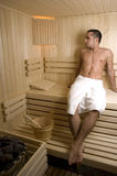 Man in sauna Stock Images