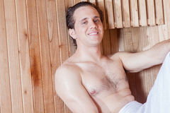 Man in sauna looking at camera Royalty Free Stock Image
