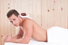 Man in sauna waiting for massage Stock Photography