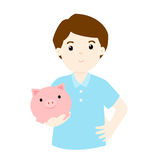 Man save money in piggy bank  Stock Photography