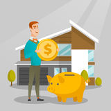 Man saving money in piggy bank for buying house. Royalty Free Stock Images