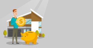 Man saving money in piggy bank for buying house. Royalty Free Stock Photography