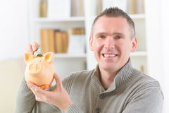 Man saving money Royalty Free Stock Photo