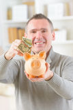 Man saving money Royalty Free Stock Photography
