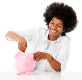 Man saving in a piggybank Stock Photo