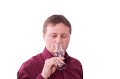 Man is savouring a grappa. A man is smelling the taste of a grappa Stock Images