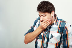 Man saw something disgusting. Feel sick as he going to vormit royalty free stock photography