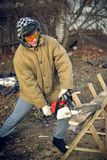 Man sawing a board. Young man sawing a board Stock Photo