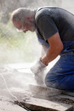 Man sawing with grinder Royalty Free Stock Photography
