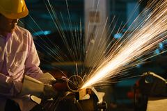 Man sawing metal by grinder Royalty Free Stock Photo