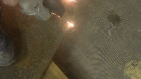 Man sawing metal by grinder, working environment stock video footage