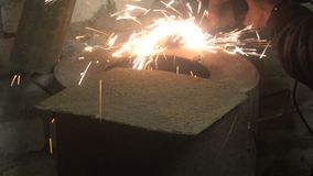 Man sawing metal by grinder, working environment stock footage