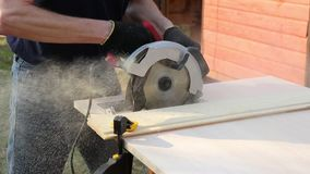 Man sawing off a board stock video footage