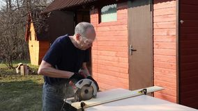 Man sawing off a board stock video