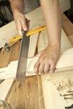 Man sawing plank Stock Photo