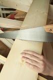Man sawing plank Royalty Free Stock Photos