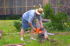 Man Sawing Up A Limb Royalty Free Stock Image