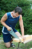 Man sawing wood royalty free stock photos