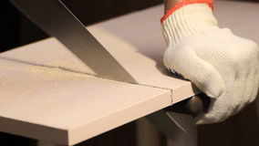 Man sawing wooden board with hand saw stock video