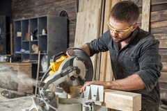Man  saws with a circular saw Royalty Free Stock Images