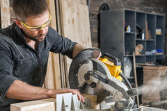 Man  saws with a circular saw Stock Images