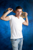 Man with sax over the shoulders Royalty Free Stock Photography