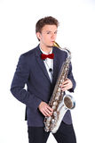 Man with saxophone Stock Images