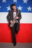 Man with saxophone Stock Photos