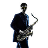 Man saxophonist playing saxophone player  silhouette Royalty Free Stock Image