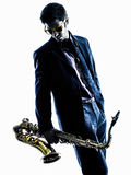 Man saxophonist playing saxophone player  silhouette Stock Images