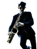 Man saxophonist playing saxophone player  silhouette Stock Image