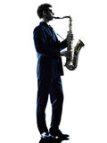 Man saxophonist playing saxophone player  silhouette Stock Photos