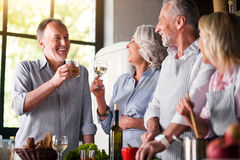 Man saying toast to a company of friends Royalty Free Stock Photography