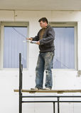 Man on scaffolding Stock Photos