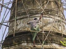 Man on scaffolding Stock Photo