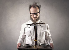 Man with scale Royalty Free Stock Image