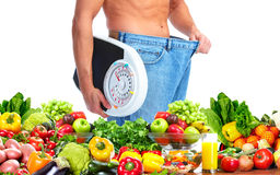 Man with scales and fruits Stock Image