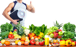 Man with scales and fruits Royalty Free Stock Photography