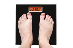Man on the scales with a lot of weight and health problems, the inscription - go run.  Royalty Free Stock Image