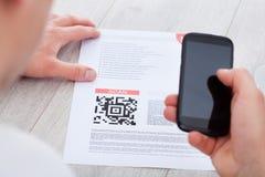 Man scanning barcode Stock Photos