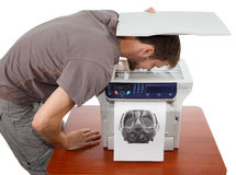 Man scanning his face in copier. On white background Royalty Free Stock Image
